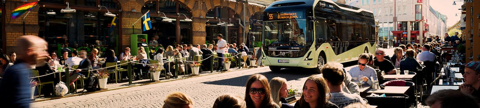 Electric bus passes through a bustling street in Gothenburg