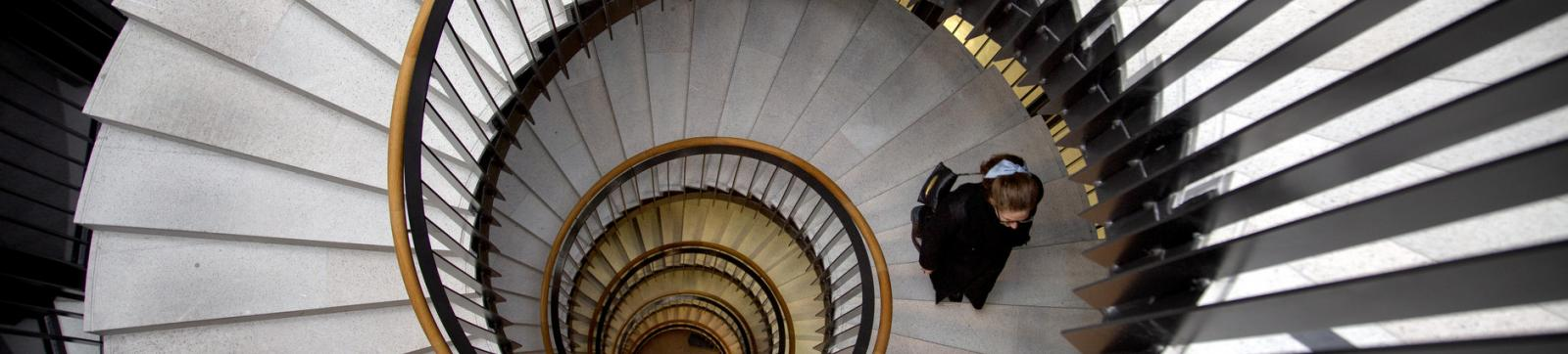 Innovation - woman walking in a spiral staircase
