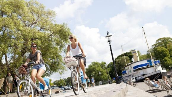 Two people riding bicycles in central Gothenburg